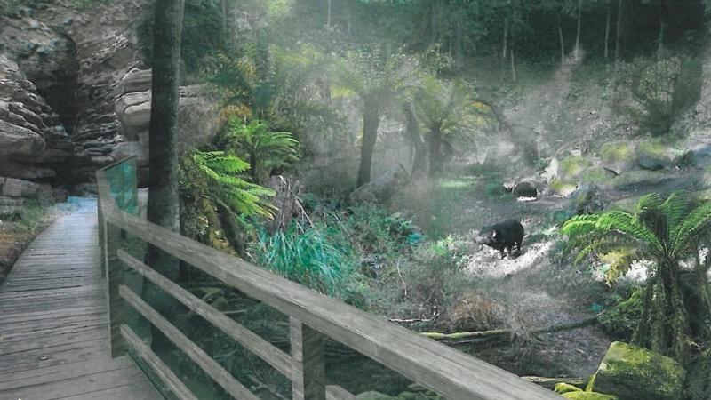 Architektonický návrh australské části připomíná Tasmánii jako civilizací dlouho neobjevený svět. Nově postavené budovy vytvoří jeden celek v podobě přírodního útvaru kráteru, který byl inspirován dopadem meteoritu na Tasmánii. Stavební objekty budou soustředěné po obvodu kružnice, v jejímž středu najdou návštěvníci nejatraktivnější přírodní výběhy. Stavba naváže na stávající svah a při pohledu z horní části zoo bude splývat s terénem.
